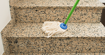 mopping marble tile